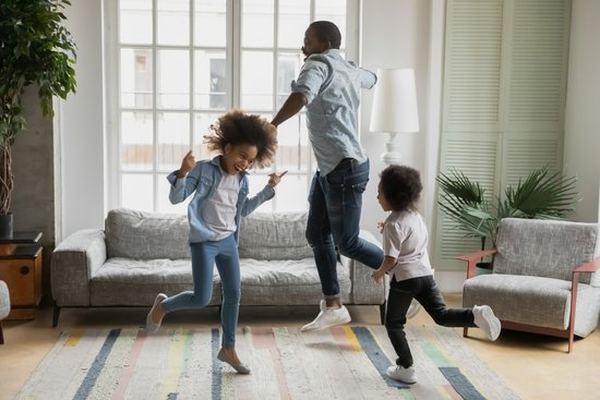 Family dancing because they are happy