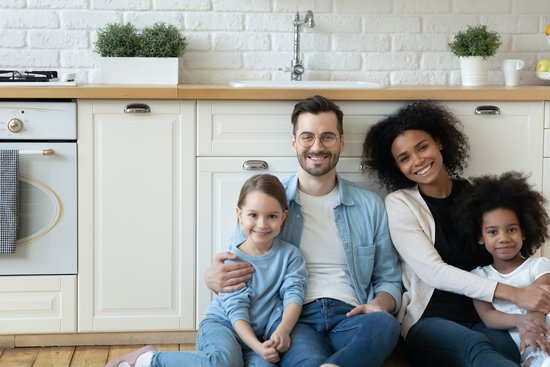 Family sitting in their kitchen in their new home