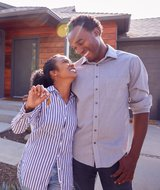Mortgages - Couple in front of Home