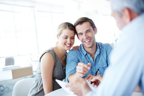 Couple looking over mortgage paperwork