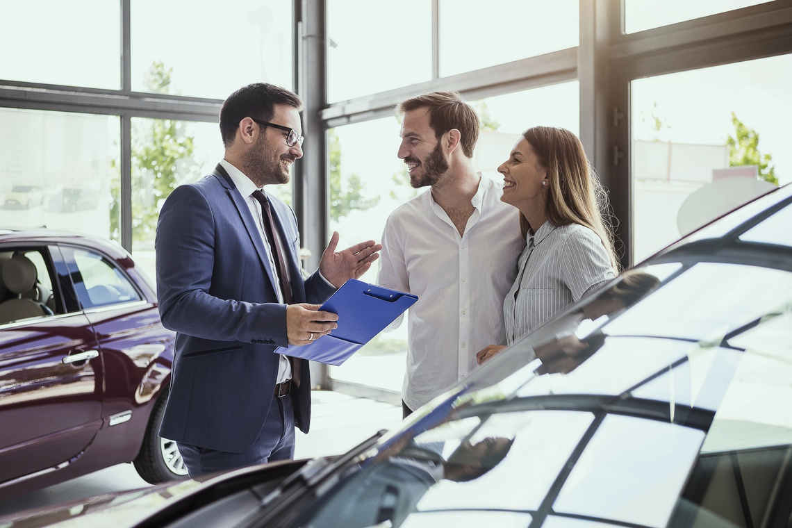 Portrait picture of Couple buying car from dealership